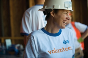 Here, Blue Cross employees volunteer with Habitat for Humanity, just one way they help in the community.
